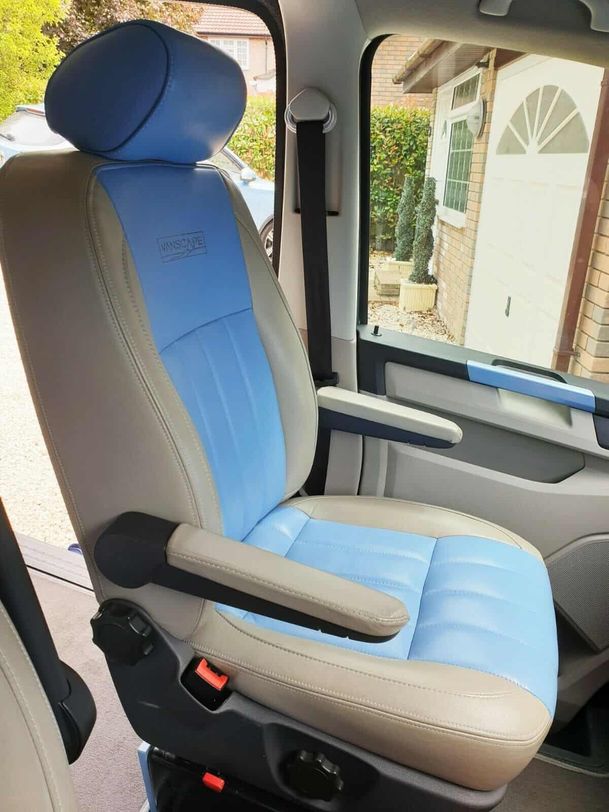 Passenger seat with dual armrest and swivel base
